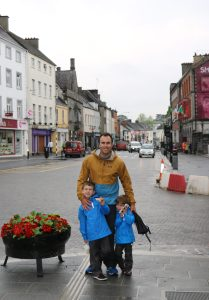 Fantastic town area - Austin ready to grab a bar stool with his pint of milk and Samuel checking in with his 'boss!'