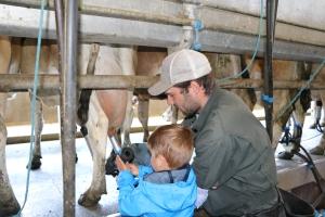 Samuel & Daniel setting up the milk machine!