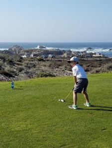 Austin focused and enjoying first ocean side golf course experience